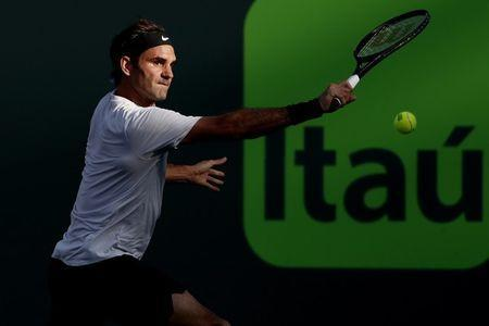 Mar 24, 2018; Key Biscayne, FL, USA; Roger Federer of Switzerland hits a backhand against Thanasi Kokkinakis of Australia (not pictured) on day five of the Miami Open at Tennis Center at Crandon Park. Mandatory Credit: Geoff Burke-USA TODAY Sports
