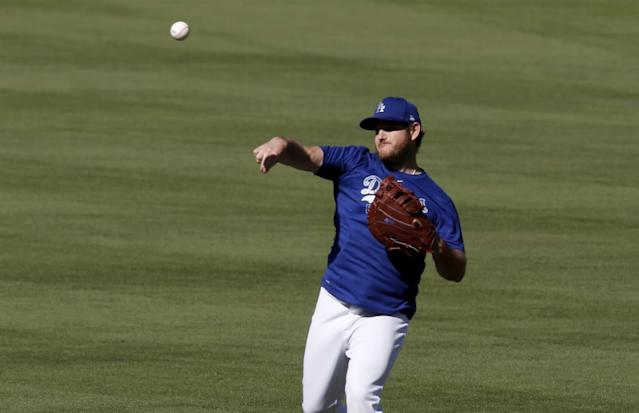 "Dodgers first baseman Max Muncy warms up during practice at Dodger Stadium on July 3. <span class=""copyright"">(Luis Sinco / Los Angeles Times)</span>"