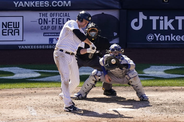 New York Yankees' Jay Bruce, left, hits a two-run single off Toronto Blue Jays relief pitcher Tim Mayza during the sixth inning of a baseball game, Saturday, April 3, 2021, in New York. (AP Photo/John Minchillo)