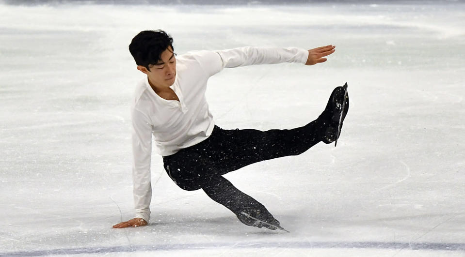 Nathan Chen of the USA falls during his performing during the Men Short Program at the Figure Skating World Championships in Stockholm, Sweden, Thursday, March 25, 2021. (AP Photo/Martin Meissner)