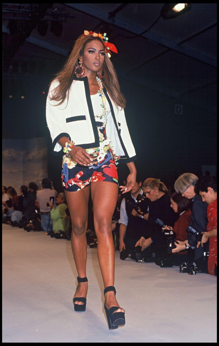 <p>Also making a big splash in the '90s were giant platform sandals, as modeled by Naomi Campbell at Chanel's Spring/Summer '92 show in Paris. Everyone wanted a pair of these shoes, no matter how unsteady they seemed. </p>