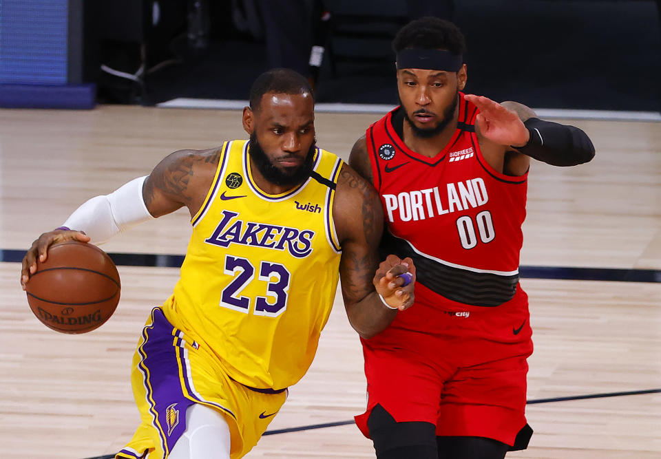 Los Angeles Lakers' LeBron James (23) drives the ball against Portland Trail Blazers' Carmelo Anthony (00) during the third quarter of Game 2 of an NBA basketball first-round playoff series, Thursday, Aug. 20, 2020, in Lake Buena Vista, Fla. (Kevin C. Cox/Pool Photo via AP)