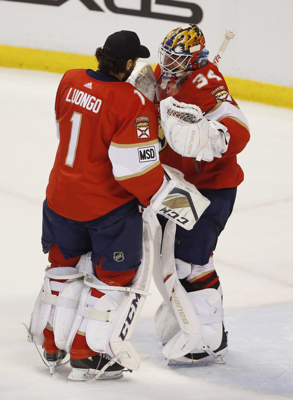 Florida Panthers goaltender Roberto Luongo (1) congratulates goaltender James Reimer (34) after they defeated the Buffalo Sabres in an NHL hockey game, Friday, March 2, 2018, in Sunrise, Fla. (AP Photo/Wilfredo Lee)