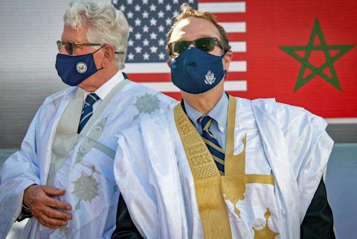 The US Ambassador to Morocco, David Fischer (L), and David Schenker, US Assistant Secretary of State for Near Eastern Affairs, pose wearing traditional robes in the disputed territory of Western Sahara on Sunday
