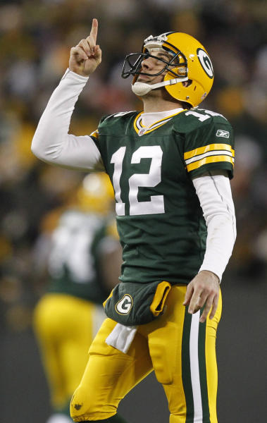 FILE - This Dec. 25, 2011 file photo shows Green Bay Packers quarterback Aaron Rodgers celebrating a touchdown pass during the second half of an NFL football game against the Chicago Bears, in Green Bay, Wis. Wear those Cheeseheads proudly, Packers fans. Your team leads the first-ever AP Pro32 NFL power rankings, a new pro football version of the AP Top 25 college football and basketball polls. (AP Photo/Jeffrey Phelps, File)