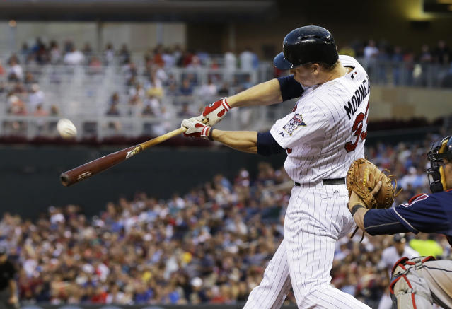Minnesota Twins' Justin Morneau flies out in the fourth inning of a baseball game off Cleveland Indians pitcher Zach McAllister , Tuesday, Aug. 13, 2013 in Minneapolis. Morneau was placed on waivers Tuesday night. (AP Photo/Jim Mone)