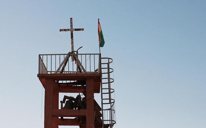 Peshmerga fighters placed a cross atop the church tower after they liberated Batnay in October. (Photo: Ash Gallagher for Yahoo News)