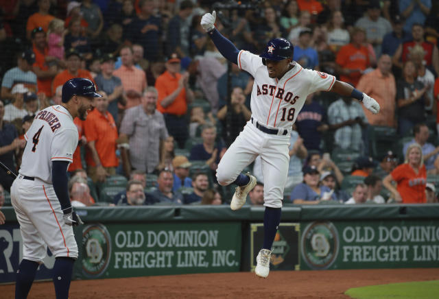 Houston Astros' Tony Kemp (18) celebrates his solo home run against the Texas Rangers as teammate George Springer (4) looks on in the sixth inning of a baseball game Saturday, July 20, 2019, in Houston. (AP Photo/Richard Carson)