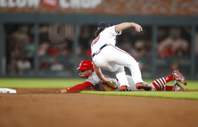 Atlanta Braves shortstop Charlie Culberson tags out St. Louis Cardinals' Kolten Wong on an attempted stolen base during the third inning of a baseball game Tuesday, Sept. 18, 2018, in Atlanta. (AP Photo/Todd Kirkland)