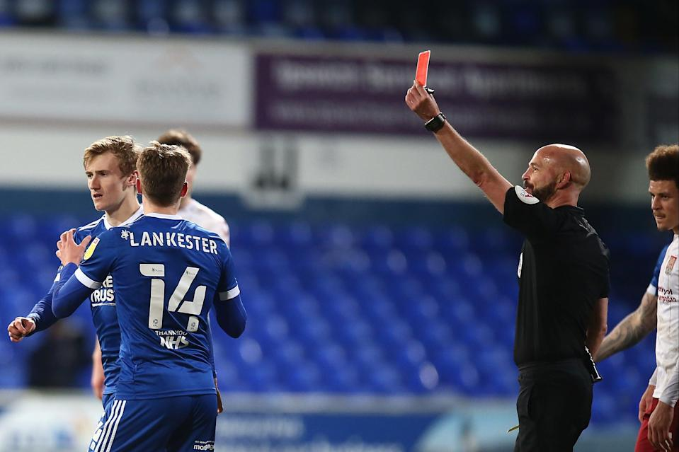 <p>Drysdale later showed Ipswich's Flynn Downes a red card</p> (Getty Images)