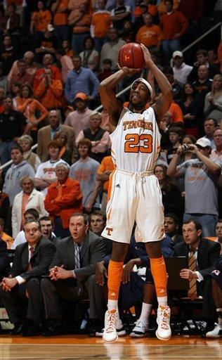 Tennessee guard Cameron Tatum (23) shoots a 3-pointer during the first half of an NCAA college basketball game against Mississippi at Thompson-Boling Arena in Knoxville, Tenn., Wednesday, Feb. 22, 2012. (AP Photo/Knoxville News Sentinel, Adam Brimer)