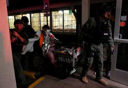 Patrick Carnes is evacuated in a Walmart cart by SWAT medics from the scene of a shooting at a Walmart where Carnes was shopping in Thornton, Colorado November 1, 2017. REUTERS/Rick Wilking