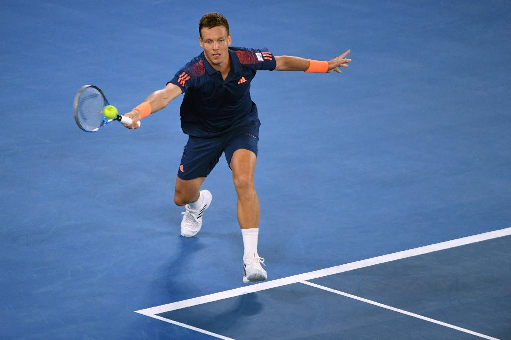 Czech Republic's Tomas Berdych hits a return against Switzerland's Roger Federer during their men's singles third round match on day five of the Australian Open tennis tournament in Melbourne on January 20, 2017 (AFP Photo/WILLIAM WEST)