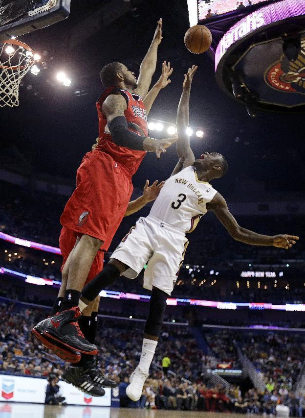 New Orleans Pelicans guard Anthony Morrow (3) goes to the basket against Portland Trail Blazers forward LaMarcus Aldridge and center Robin Lopez, behind, in the first half of an NBA basketball game in New Orleans, Monday, Dec. 30, 2013. (AP Photo/Gerald Herbert)