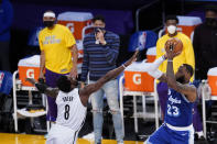 Los Angeles Lakers forward LeBron James (23) shoots over Brooklyn Nets forward Jeff Green (8) during the first half of an NBA basketball game Thursday, Feb. 18, 2021, in Los Angeles. (AP Photo/Marcio Jose Sanchez)