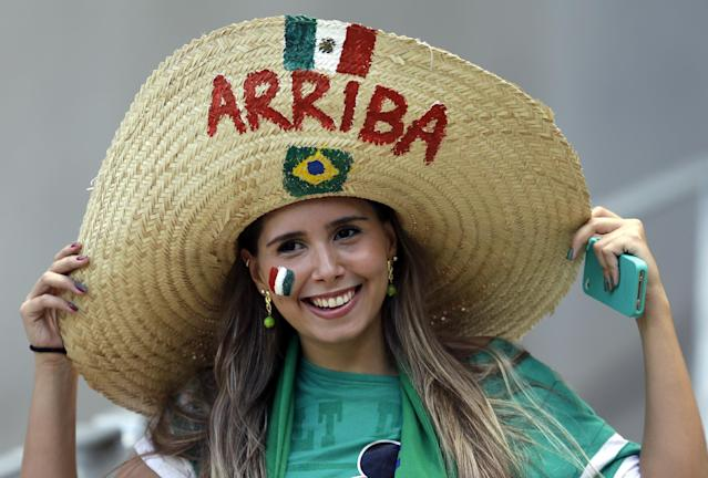 A Mexican supporter smiles before the World Cup round of 16 soccer match between the Netherlands and Mexico at the Arena Castelao in Fortaleza, Brazil, Sunday, June 29, 2014. (AP Photo/Natacha Pisarenko)
