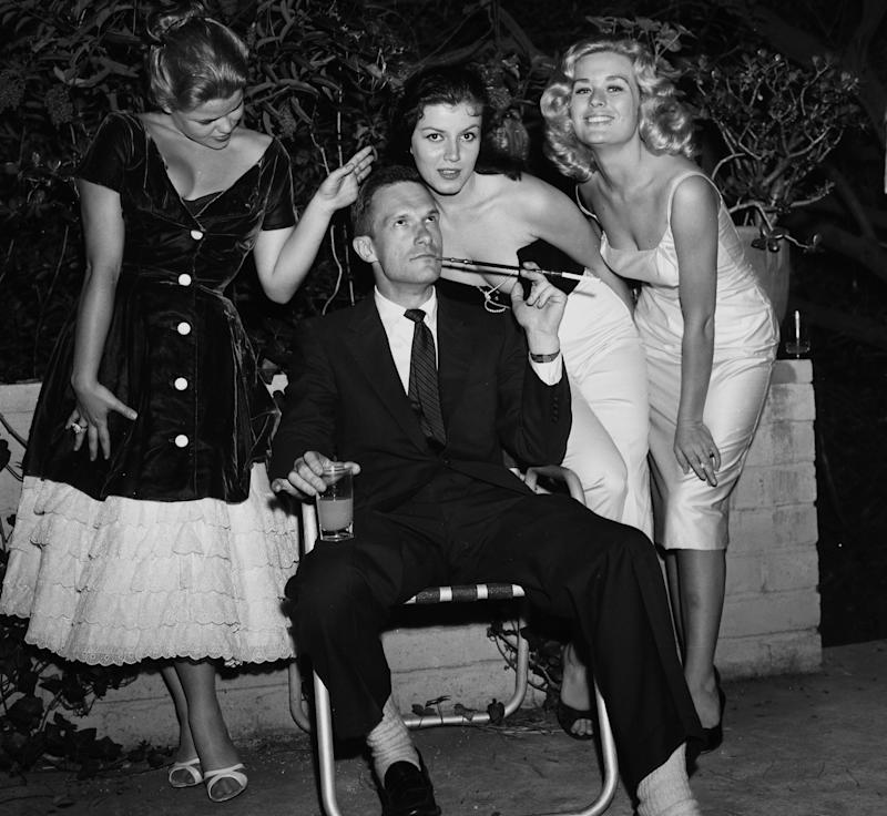 Hugh Hefner with Sylvia Sidney, Joan Bradshaw and Caroline Mitchell at a Playboy  party in Los Angeles on June 26, 1957.