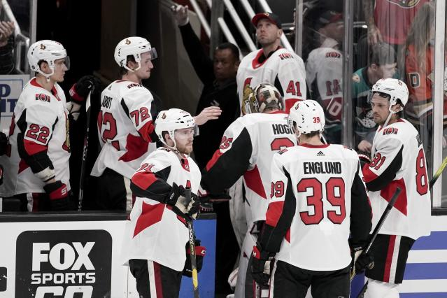 The Ottawa Senators leave the ice after their 5-2 loss against the Anaheim Ducks during an NHL hockey game in Anaheim, Calif., Tuesday, March 10, 2020. (AP Photo/Chris Carlson)