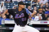 New York Mets pitcher Carlos Carrasco winds up during the second inning of the team's baseball game against the Cincinnati Reds, Friday, July 30, 2021, in New York. (AP Photo/Mary Altaffer)