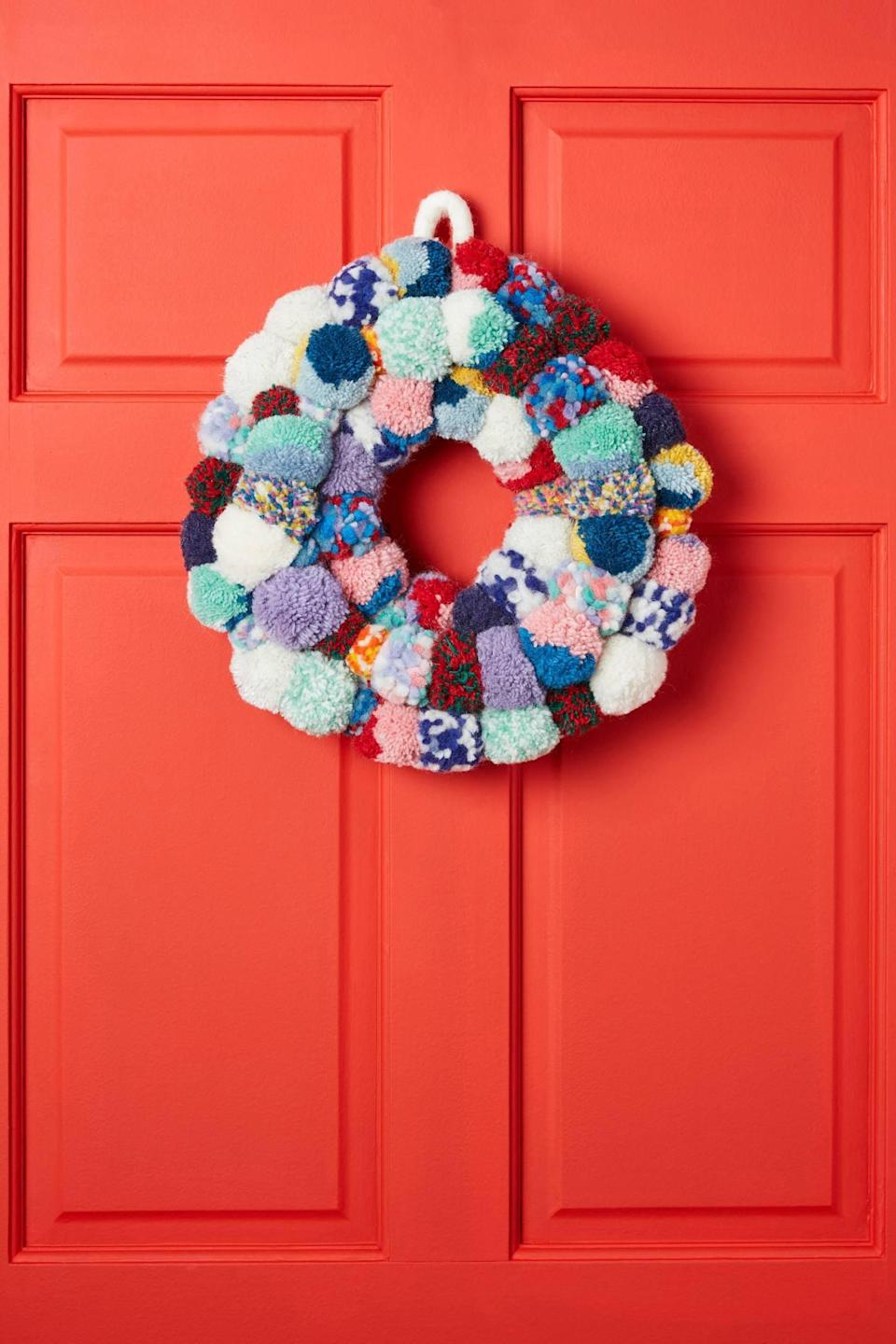 """<p>Hang a festive, squishy wreath on your front door with the <a href=""""https://www.popsugar.com/buy/Pom-Pom-Bonanza-Wreath-490452?p_name=Pom%20Pom%20Bonanza%20Wreath&retailer=anthropologie.com&pid=490452&price=118&evar1=casa%3Aus&evar9=46615300&evar98=https%3A%2F%2Fwww.popsugar.com%2Fhome%2Fphoto-gallery%2F46615300%2Fimage%2F46615322%2FPom-Pom-Bonanza-Wreath&list1=shopping%2Canthropologie%2Choliday%2Cchristmas%2Cchristmas%20decorations%2Choliday%20decor%2Chome%20shopping&prop13=mobile&pdata=1"""" rel=""""nofollow noopener"""" class=""""link rapid-noclick-resp"""" target=""""_blank"""" data-ylk=""""slk:Pom Pom Bonanza Wreath"""">Pom Pom Bonanza Wreath</a> ($118).</p>"""