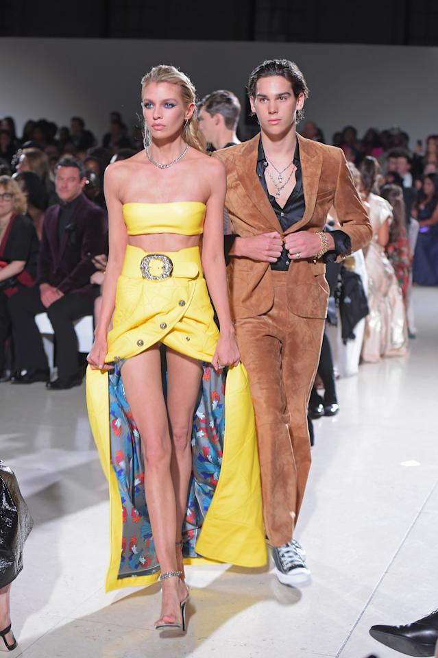 Stella Maxwell and Paris Brosnan walk the runway at the Spring Summer 2020 Fashion For Relief show during London Fashion Week [Photo: Getty Images]