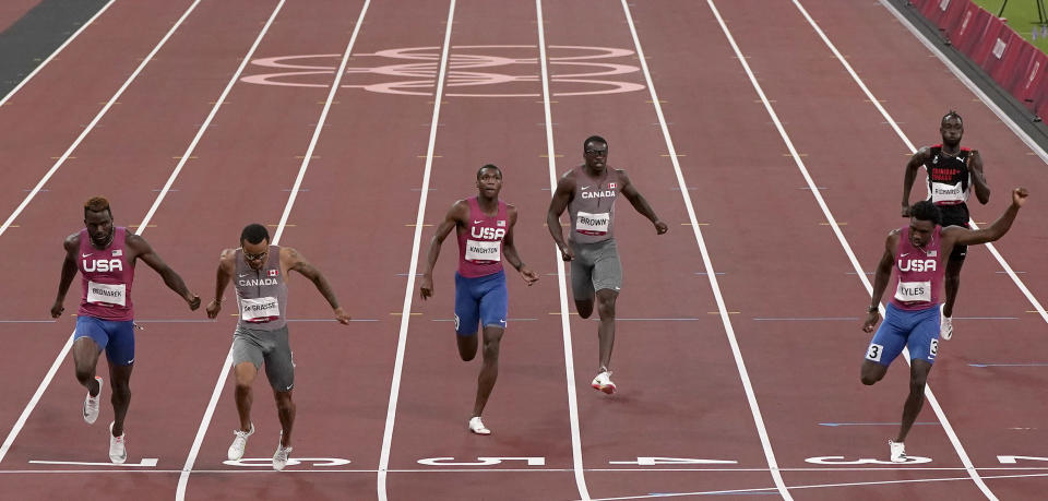 Andre De Grasse, of Canada races to win the gold medal ahead of Kenneth Bednarek, of United States, silver, and Noah Lyles, of United States, bronze, in the final of the men's 200-meters at the 2020 Summer Olympics, Wednesday, Aug. 4, 2021, in Tokyo, Japan. (AP Photo/Charlie Riedel)