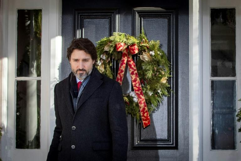 """Canadian Prime Minister Justin Trudeau, pictured on December 18, 2020, has told Canadians """"now is not the right time for a vacation abroad"""""""