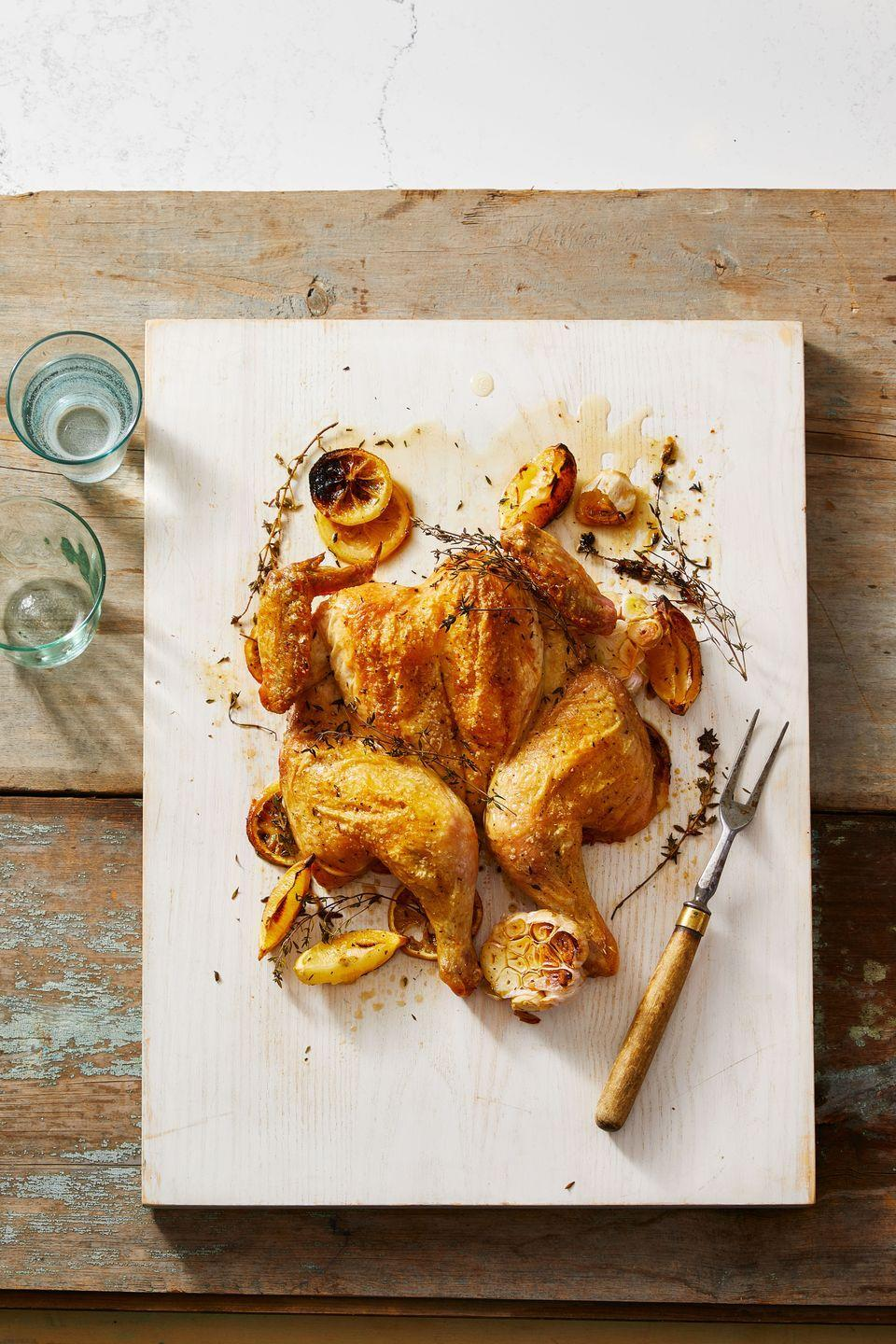 """<p>With these simple steps to spatchcocking (a.k.a. butterflying) a chicken, we've made sure that you'll have a perfectly cooked bird — in a lot less time than it normally takes.</p><p><em><a href=""""https://www.goodhousekeeping.com/food-recipes/cooking/a30383617/how-to-spatchcock-a-chicken/"""" rel=""""nofollow noopener"""" target=""""_blank"""" data-ylk=""""slk:Get the recipe for Spatchcock Chicken »"""" class=""""link rapid-noclick-resp"""">Get the recipe for Spatchcock Chicken »</a></em></p>"""
