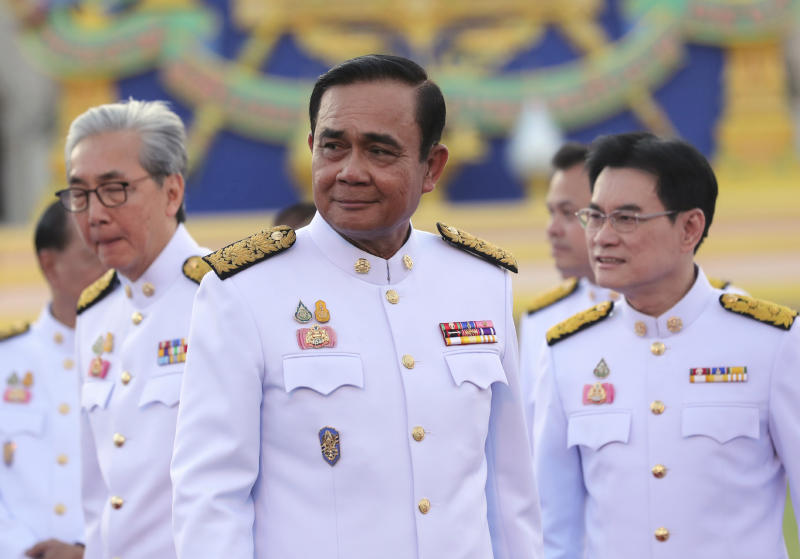 Thailand's Prime Minister Prayuth Chan-ocha attends a group photo with his cabinet members at the government house in Bangkok Tuesday, July 16, 2019. Prayuth on Tuesday led his 36 cabinet members to take their oaths in front of Thailand's King Maha Vajiralongkorn. (AP Photo/Sakchai Lalit)