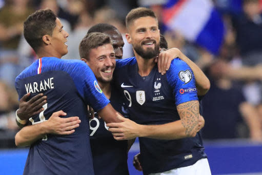France's Clement Lenglet, centre, celebrates his goal with France's Olivier Giroud, right, and France's Raphael Varane, left, during the Euro 2020 group H qualifying soccer match between France and Andorra at the Stade de France in Saint Denis, north of Paris, France, Tuesday, Sept. 10, 2019. (AP Photo/Michel Euler)