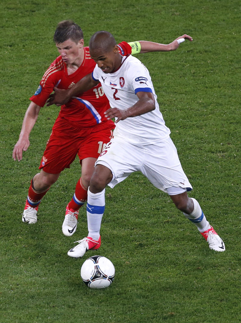 Russia's Andrei Arshavin, left, and Czech Republic's Theodor Gebre Selassie vie for the ball during the Euro 2012, Group A soccer match between Russia and Czech Republic, in Wroclaw, Poland, Friday, June 8, 2012.  (AP Photo/Anja Niedringhaus)