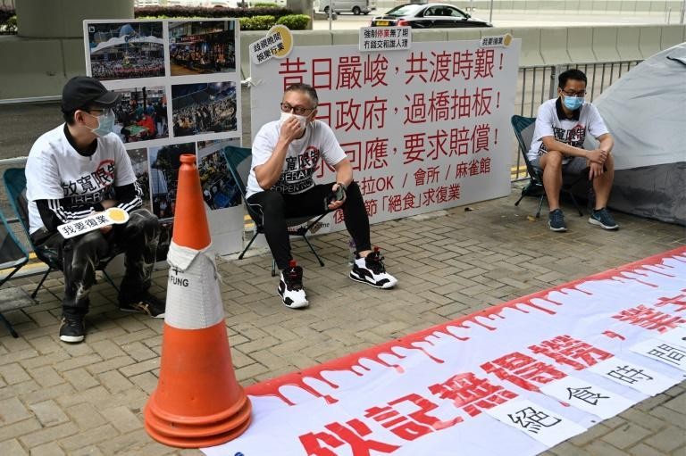 A group of bar, karaoke and mahjong parlour owners have started a symbolic hunger strike to protest against coronavirus closures