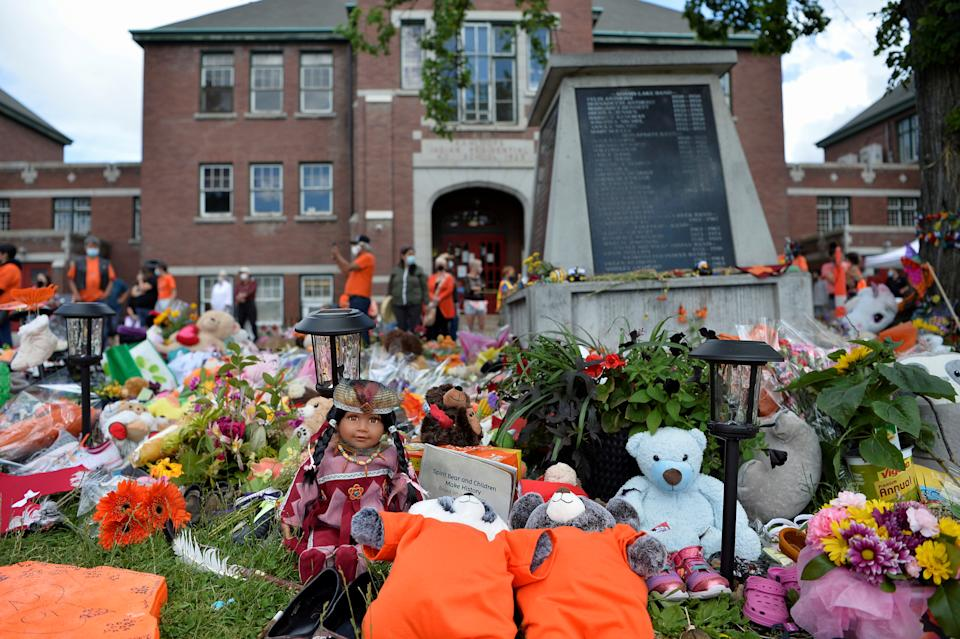 A memorial on the grounds of the former Kamloops Indian Residential School is seen after the remains of 215 children, some as young as three years old, were found at the site in Kamloops, British Columbia, Canada June 5, 2021.  REUTERS/Jennifer Gauthier     TPX IMAGES OF THE DAY