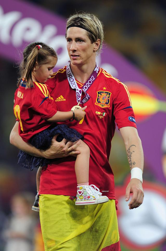 KIEV, UKRAINE - JULY 01: Fernando Torres of Spain and his daughter Nora on the pitch after the UEFA EURO 2012 final match between Spain and Italy at the Olympic Stadium on July 1, 2012 in Kiev, Ukraine. (Photo by Shaun Botterill/Getty Images)