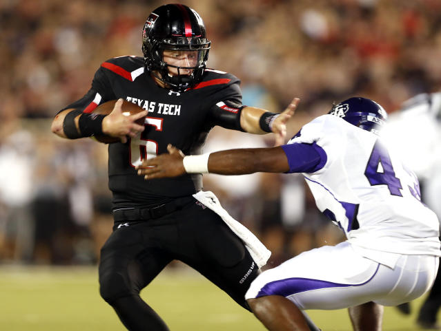 Texas Tech's Baker Mayfield looks to escape a tackle from Stephen F. Austin's Nick Bryant during their NCAA college football game in Lubbock, Texas, Saturday, Sept. 7, 2013. (AP Photo/Lubbock Avalanche-Journal, Stephen Spillman)