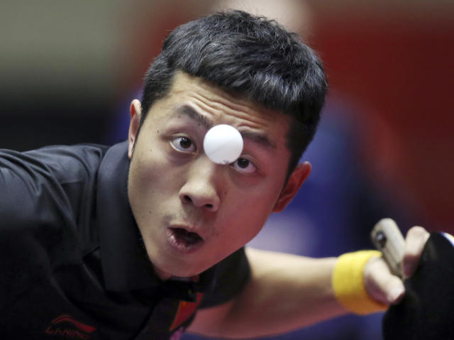 10ThingstoSeeSports - Xu Xin of China plays against Zolt Pete of Serbia during their round robin match of the World Team Table Tennis Championships in Tokyo, Thursday, May 1, 2014. (AP Photo/Koji Sasahara, File)