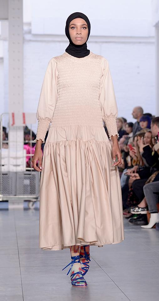 <p>Designer Molly Goddard sent a diverse set of models down the runway, including one who accessorized her ruched maxidress with a traditional headscarf. </p>