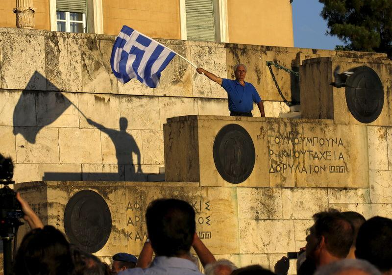Protesters gather in front of the parliament in Athens