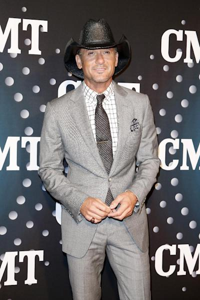 """Tim McGraw poses on the red carpet at the CMT """"Artists of the Year"""" event at Bridgestone Arena, on Tuesday, December 3, 2013, in Nashville, Tenn. (Photo by Donn Jones/Invision/AP)"""