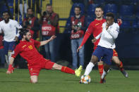 In his debut match for England, Callum Hudson-Odoi, right, vies for the ball with Montenegro's Marko Jankovic, left, during the Euro 2020 group A qualifying soccer match between Montenegro and England at the City Stadium in Podgorica, Montenegro, Monday, March 25, 2019. (AP Photo/Darko Vojinovic)