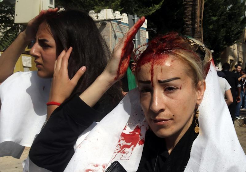Lebanese Shiite Muslim women take part in a self-flagellation procession to mark Ashura, in the southern Lebanese city of Nabatiyeh on October 24, 2015 (AFP Photo/Mahmoud Zayyat)