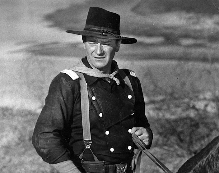 """In this undated photo, John Wayne appears during the filming of """"The Horse Soldiers."""""""