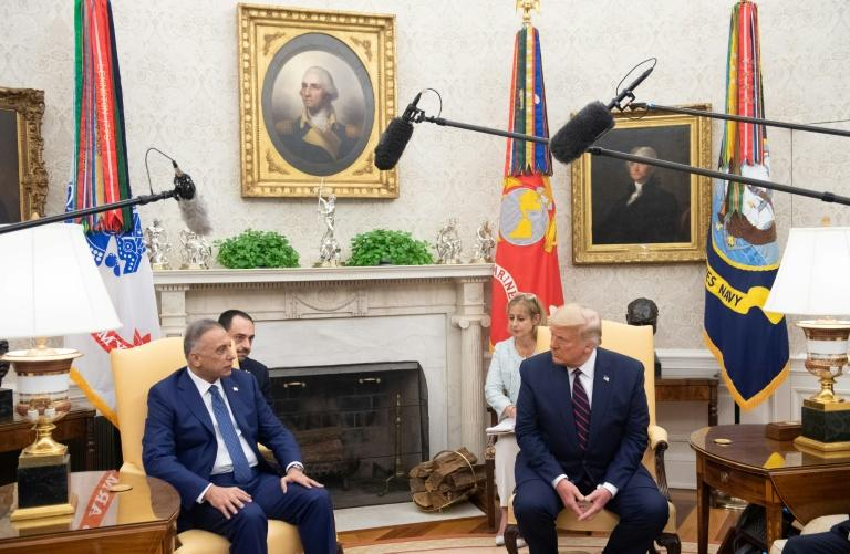 New US threats to Iraq widen rifts, leave PM exposed
