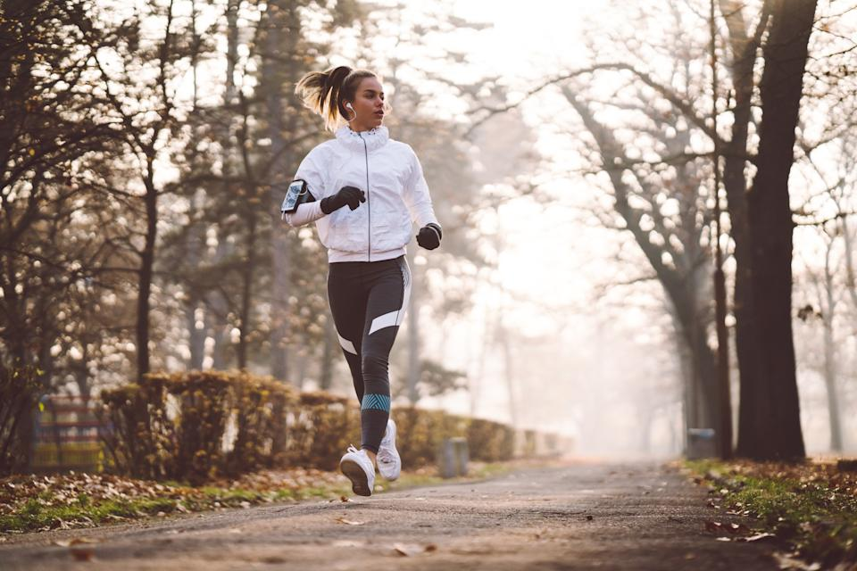 Sports woman exercising among nature in a winter day