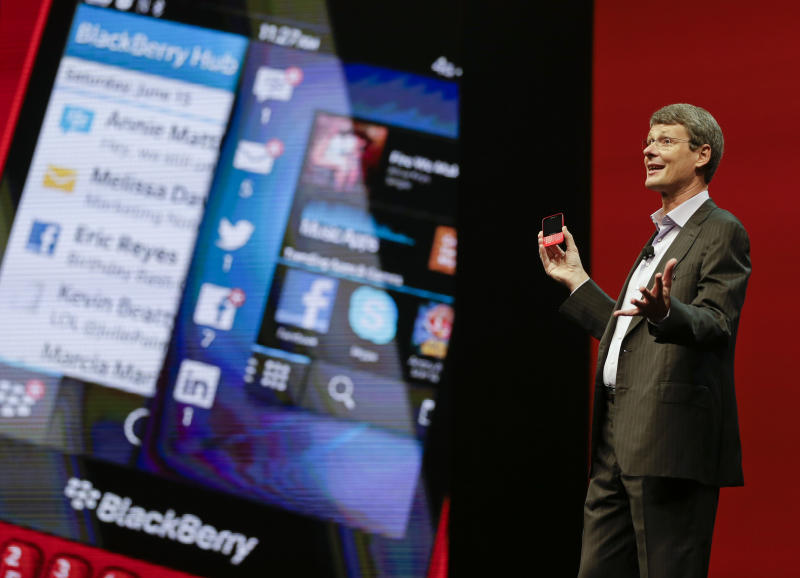 Thorsten Heins, president and CEO at BlackBerry speaks at Research In Motion's annual conference, Tuesday, May 14, 2013, in Orlando, Fla. Heins said Tuesday that the time is right to offer BBM on rival devices. He says iPhone and Android versions will be available for free. (AP Photo/John Raoux)
