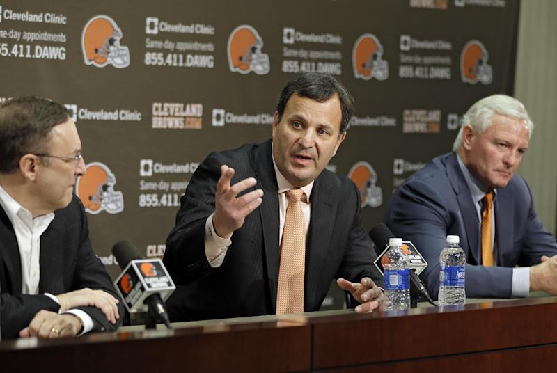 Mike Lombardi, center, the Cleveland Browns vice president of player personnel, answers questions at during an NFL football news conference with CEO Joe Banner, left, and owner Jimmy Haslam at the team's practice facility in Berea, Ohio, Friday, Jan. 18, 2013. (AP Photo/Mark Duncan)