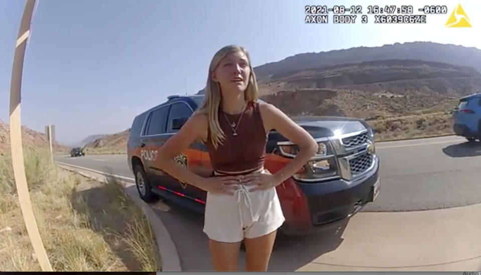 """This police camera video provided by The Moab Police Department shows Gabrielle """"Gabby"""" Petito talking to a police officer after police pulled over the van she was traveling in with her boyfriend, Brian Laundrie, near the entrance to Arches National Park on Aug. 12, 2021. The couple was pulled over while they were having an emotional fight. Petito was reported missing by her family a month later and is now the subject of a nationwide search. (The Moab Police Department via AP)"""