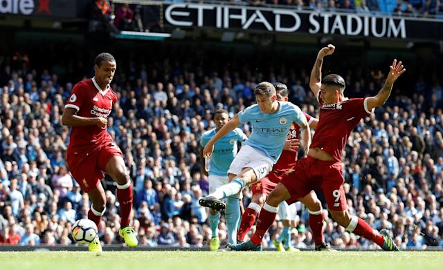 <p>Manchester City's John Stones shoots at goal </p>