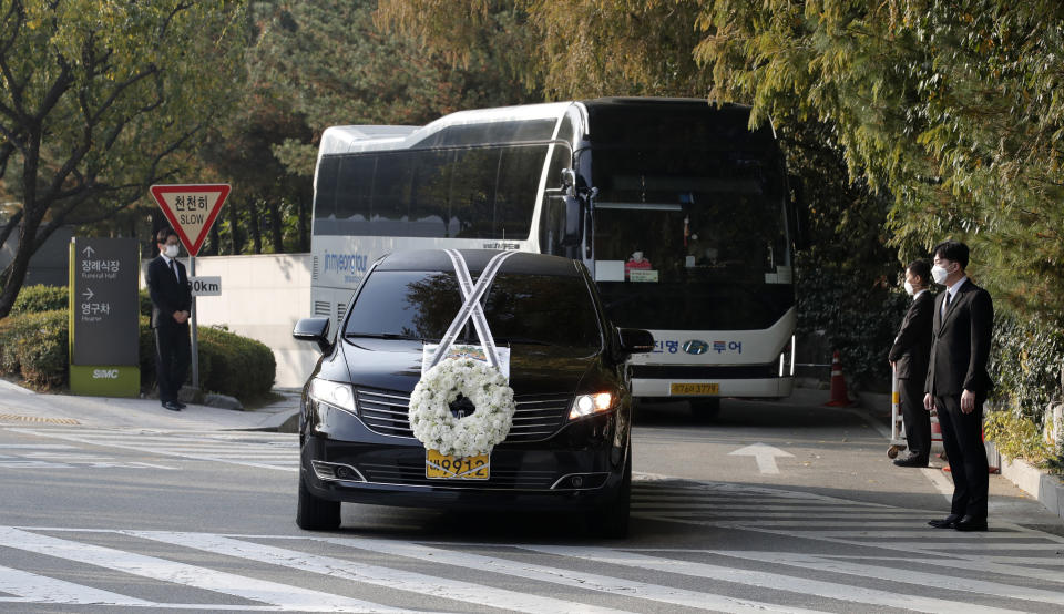 A hearse of the late Samsung Electronics Chairman Lee Kun-Hee leaves outside a funeral hall in Seoul, South Korea, Wednesday, Oct. 28, 2020. As Samsung Electronics mourns the death of its long-time chairman, Lee Kun-Hee, questions loom over what's next for South Korea's biggest company. Samsung has struggled for years to diversify from its core hardware business to tap new technologies and services.(AP Photo/Lee Jin-man)