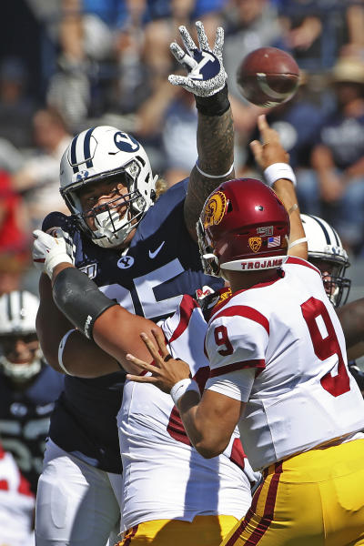 BYU defensive lineman Khyiris Tonga (95) tries to knock down a pass from Southern California quarterback Kedon Slovis (9) in the first half of an NCAA college football game, Saturday, Sept. 14, 2019, in Provo, Utah. BYU defeated USC 30-27. (AP Photo/George Frey)